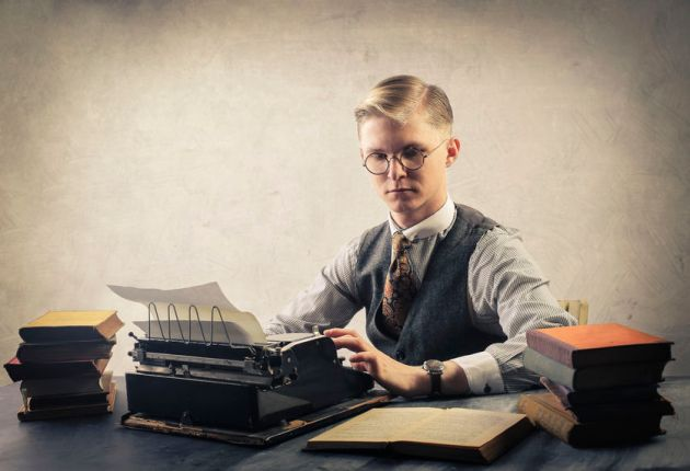 59291122 - man using a typewriter